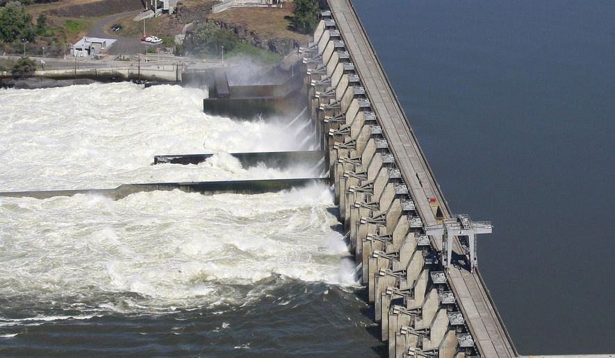 FILE - This June 3, 2011, file photo shows the Dalles Dam in the Columbia River, in Dalles, Ore. Federal authorities defended Tuesday, June 23, 2015, their latest plan for mitigating damage to salmon and steelhead imperiled by hydroelectric dams in the Columbia River Basin. (AP Photo/Rick Bowmer, File)