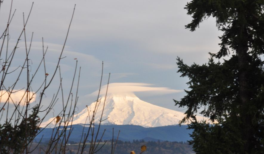 This Nov. 26, 2011 photo taken from Bluff Road about 30 miles east of Portland, shows the Sandy River valley in the foreground, and in the background Mount Hood, Oregon's tallest mountain.  Bluff Road is part of a web of scenic back roads in the Portland area that are popular with cyclists. (AP/Terrence Petty)