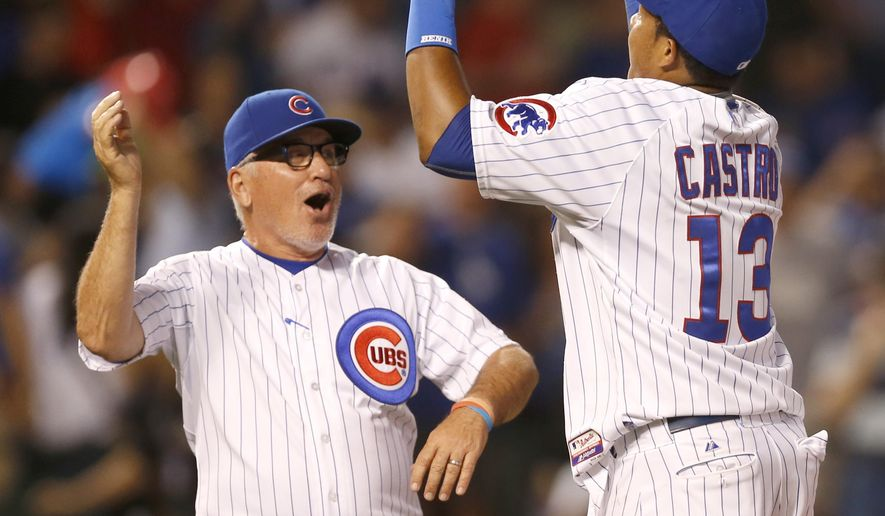 Chicago Cubs manager Joe Maddon, left, and shortstop Starlin Castro celebrate the Cubs' 4-2 win over the Los Angeles Dodgers after a baseball game Monday, June 22, 2015, in Chicago. (AP Photo/Charles Rex Arbogast)