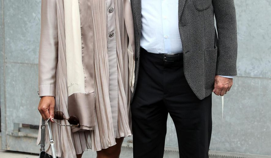 US actor Robert De Niro, right, poses with his wife Grace Hightower as they arrive for the unveiling of the Giorgio Armani men's Spring-Summer 2016 collection, during the Milan Fashion Week, in Milan, Italy, Tuesday, June 23, 2015 (Matteo Bazzi/ANSA via AP) ITALY OUT