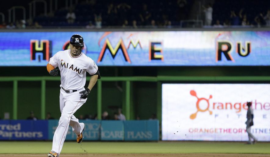 Miami Marlins' Giancarlo Stanton rounds second base as he heads for home after he hits a two run home run scoring Christian Yelich, during the first inning of a baseball game against the St. Louis Cardinals, Tuesday, June 23, 2015, in Miami. (AP Photo/Wilfredo Lee)