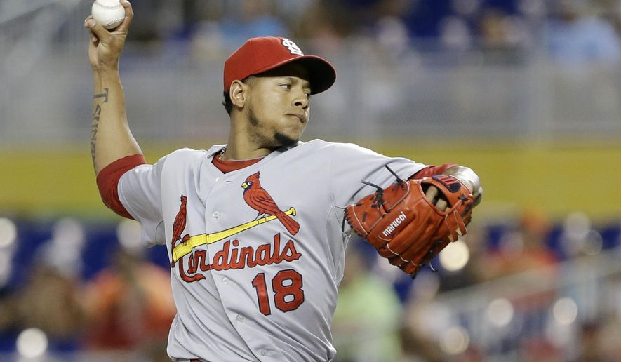 St. Louis Cardinals' Carlos Martinez delivers a pitch during the first inning of a baseball game against the Miami Marlins, Tuesday, June 23, 2015, in Miami. (AP Photo/Wilfredo Lee)