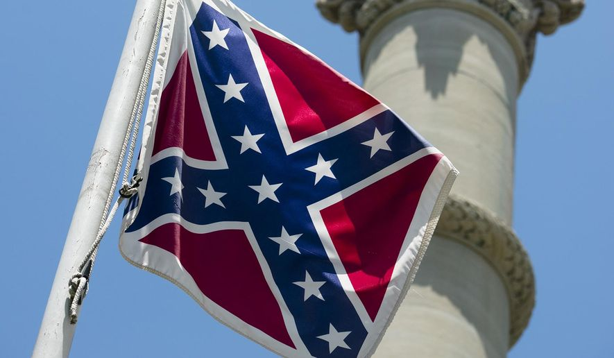A Confederate flag flies next to the Alabama Confederate Memorial on the grounds of the Alabama Capitol building in Montgomery, Ala., on June 22, 2015. (Albert Cesare/The Montgomery Advertiser via Associated Press)