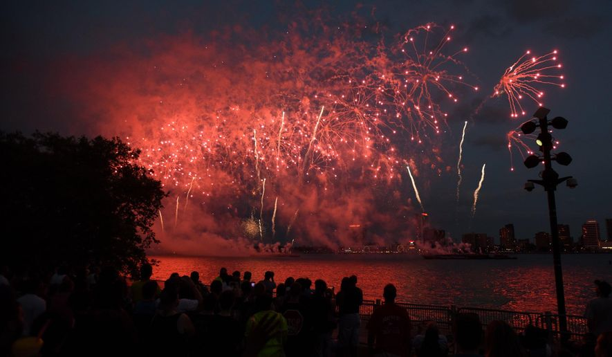 Fireworks explode in a show of light and sound on the Detroit River Monday, June 22, 2015. Thousands enjoyed the 2015 Ford Fireworks from Detroit's Hart Plaza. The annual firework show was moved up an hour due to threat of severe thunderstorms. (Tanya Moutzalias/MLive Detroit via AP)