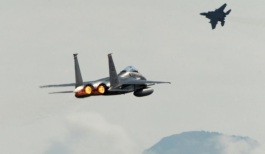 A pair of F-15C Eagles from the 18th Wing at Kadena Air Base, in Japan, take off from Joint Base Elmendorf-Richardson near Anchorage, Alaska, Tuesday, June 23, 2015, while participating in Northern Edge, a joint training exercise. (Bill Roth/Alaska Dispatch News via AP) ** FILE **