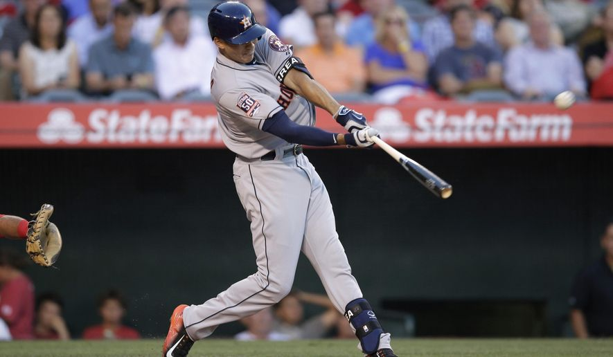 ADDS LAST NAME OF BATTER  - Houston Astros' Carlos Correa hits a three-run home run during the second inning of a baseball game against the Los Angeles Angels, Tuesday, June 23, 2015, in Anaheim, Calif. (AP Photo/Jae C. Hong)