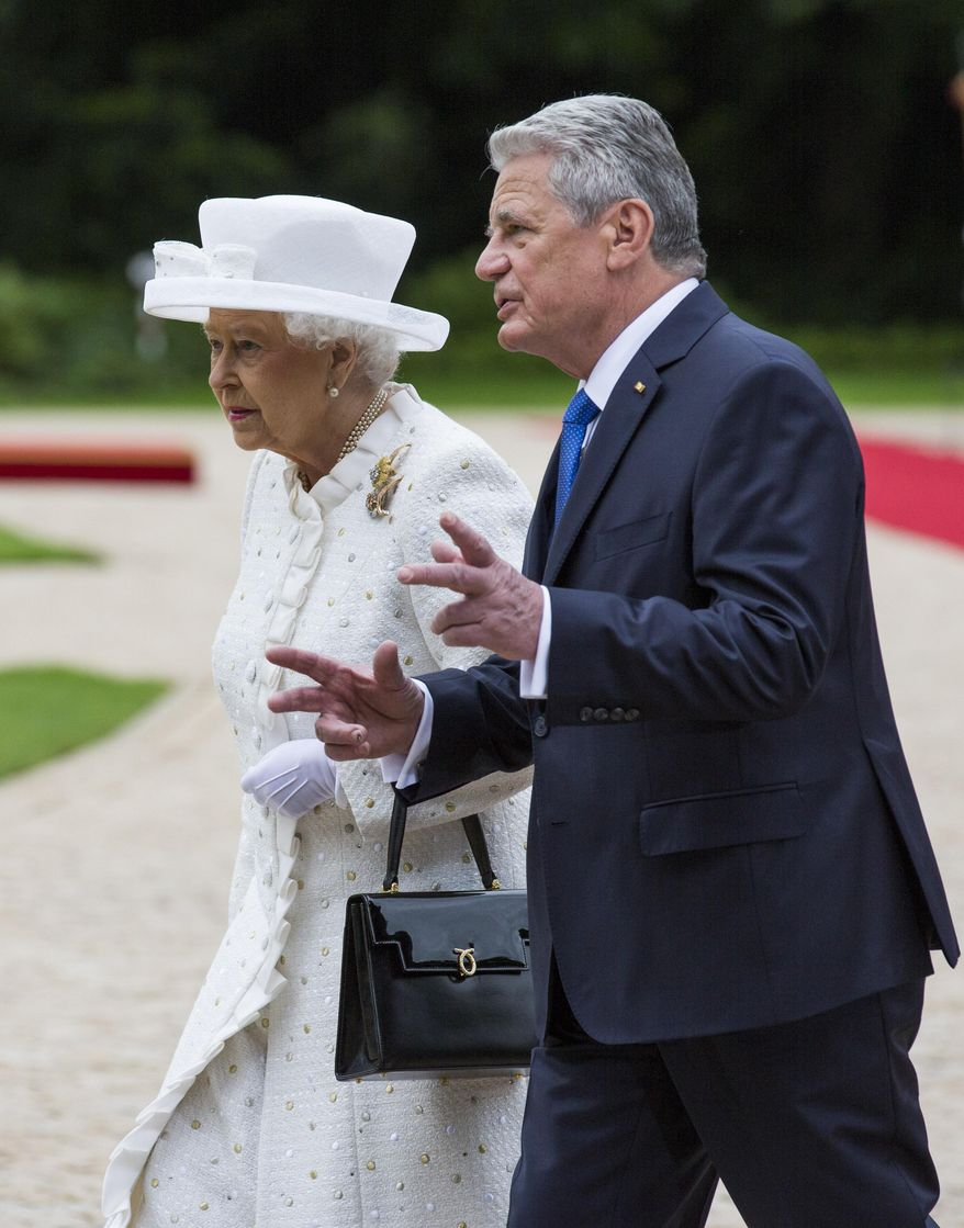 German President Joachim Gauck, right , talks to Britain's Queen Elizabeth II after a military welcoming ceremony at the Bellevue Palace in Germany's capital Berlin, Wednesday June 24, 2015. Queen Elizabeth II and her husband Prince Philip are on an official visit to Germany until Friday, June 26. (AP Photo/Gero Breloer)
