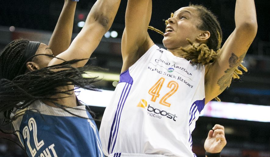 FILE - In this Aug. 9, 2014, file photo, Phoenix Mercury center Brittney Griner is fouled by Minnesota Lynx guard Monica Wright during a WNBA basketball game in Phoenix. Griner is eager to make her season debut this weekend in Minnesota after being entangled in a series of troubling off-court episodes. The 6-foot-8 star will return to the Phoenix Mercury lineup Saturday, June 27, 2015, having served her record seven-game suspension after a domestic violence arrest in April.(Pat Shanahan/The Arizona Republic via AP,  File) MESA OUT  MARICOPA COUNTY OUT; MAGS OUT; NO SALES