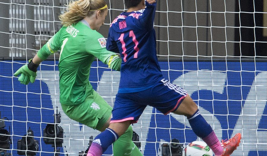 Japan's Shinobu Ohno tries to get the ball past Netherlands goalkeeper Loes Geurts, left, during the first half of a round of 16 soccer match at the FIFA Women's World Cup, Tuesday, June 23, 2015, in Vancouver, British Columbia, Canada. (Jonathan Hayward/The Canadian Press via AP)