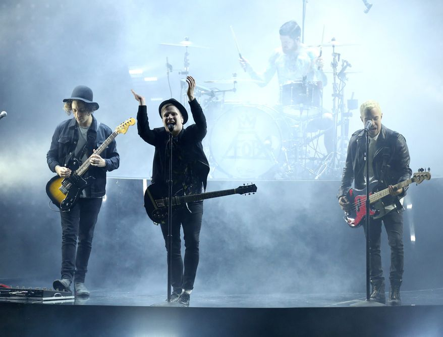 Joe Trohman, from left, Patrick Stump, Andy Hurley, on drums, and Pete Wentz of the musical group Fall Out Boy perform at the MTV Movie Awards at the Nokia Theatre on Sunday, April 12, 2015, in Los Angeles. (Photo by Matt Sayles/Invision/AP)