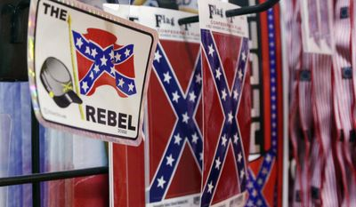 Major retailers, including Amazon, Sears, eBay, Etsy and Wal-Mart, are halting sales of the Confederate flag and other such related merchandise. (Associated Press)