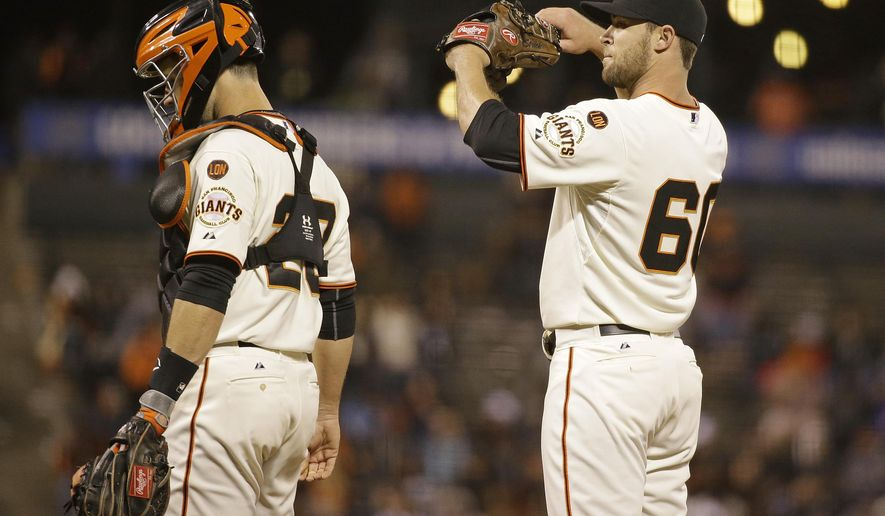 San Francisco Giants relief pitcher Hunter Strickland, right, stands on the mound after talking with catcher Buster Posey, left, in the 11th inning of their baseball game against the San Diego Padres Tuesday, June 23, 2015, in San Francisco. San Diego won the game 3-2 in 11 innings and Strickland was the losing pitcher. (AP Photo/Eric Risberg)