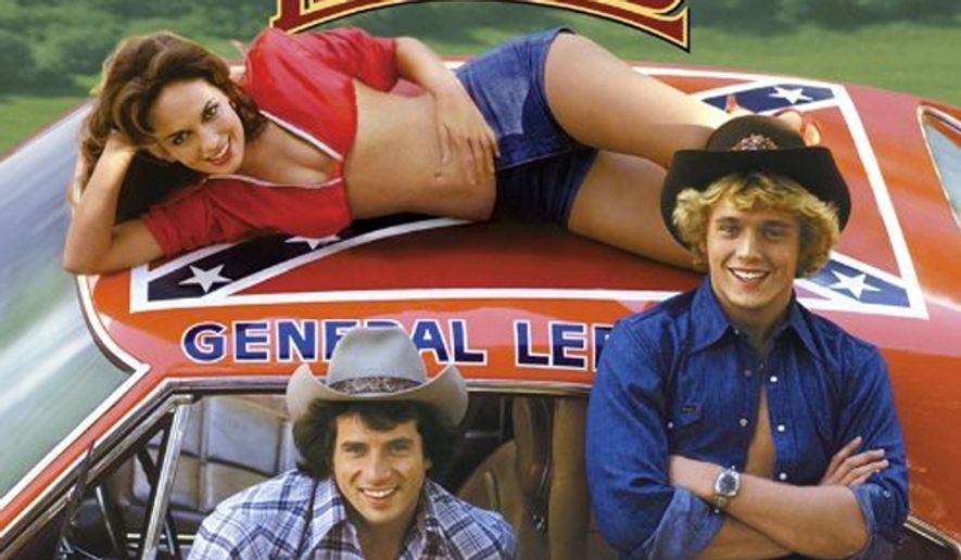 "Bo Duke (John Schneider), Daisy Duke (Catherine Bach), and Luke Duke (Tom Wopat) pose for a promotion image for ""The Dukes of Hazzard"" in 1979. (Image: Warner Bros.) ** FILE **"