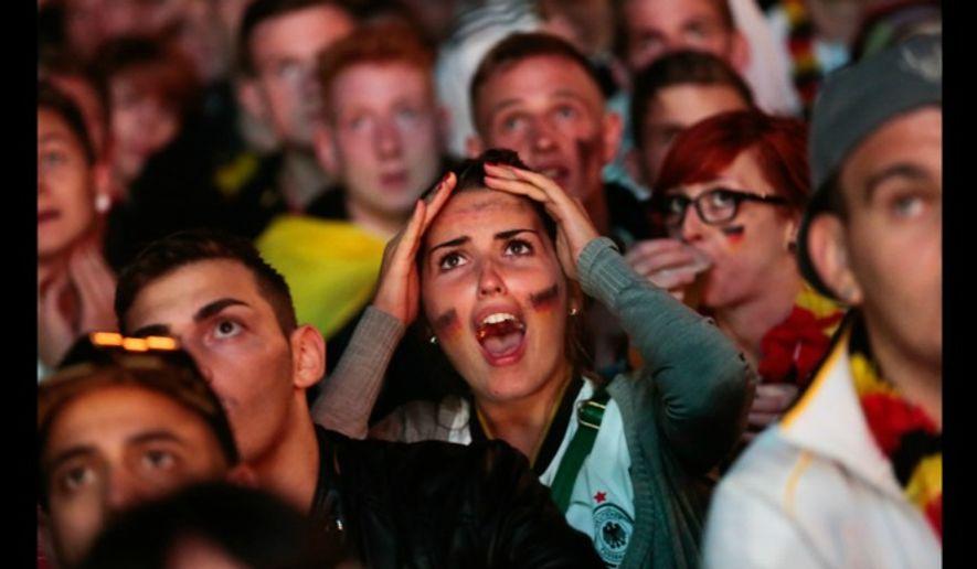 German soccer fans watch a July 2014 World Cup match in Berlin. (Associated Press) ** FILE **