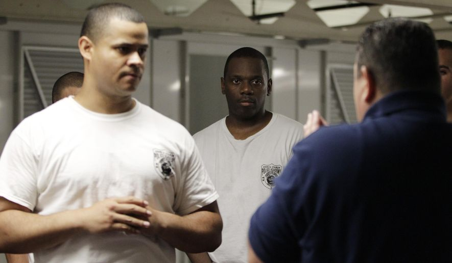 "In this Wednesday, June 17, 2015,  Jersey City Police Department officer Victor Ransom, center, watches as Sgt. Morgan Torres, right, uses Jeison Martinez, left, to demonstrate a self defense technique during a training session in Jersey City, N.J. Police recruiting is entering a new age. Scrutiny and hostility for officers have amplified. Hampered by low pay and threats to generous pension plans, some of the country's largest police forces saw significant drops in applicants long before chants of ""hands up, don't shoot,"" ''I can't breathe"" and ""black lives matter"" entered the zeitgeist. Attaining and maintaining diversity remains a challenge. (AP Photo/Julio Cortez)"