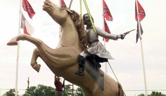 In this 1998 file photo, a statue of Confederate Gen. Nathan Bedford Forrest is put up on private property along Interstate 65 in Nashville, Tenn. The statue is one of several of Forrest, an early leader of the Ku Klux Klan, that have come under question after a massacre at a black church in Charleston, S.C. Following the massacre, a bipartisan mix of officials across the country is calling for the removal of Confederate flags and other symbols of the Confederacy from public places. (AP Photo/Mark Humphrey, File)