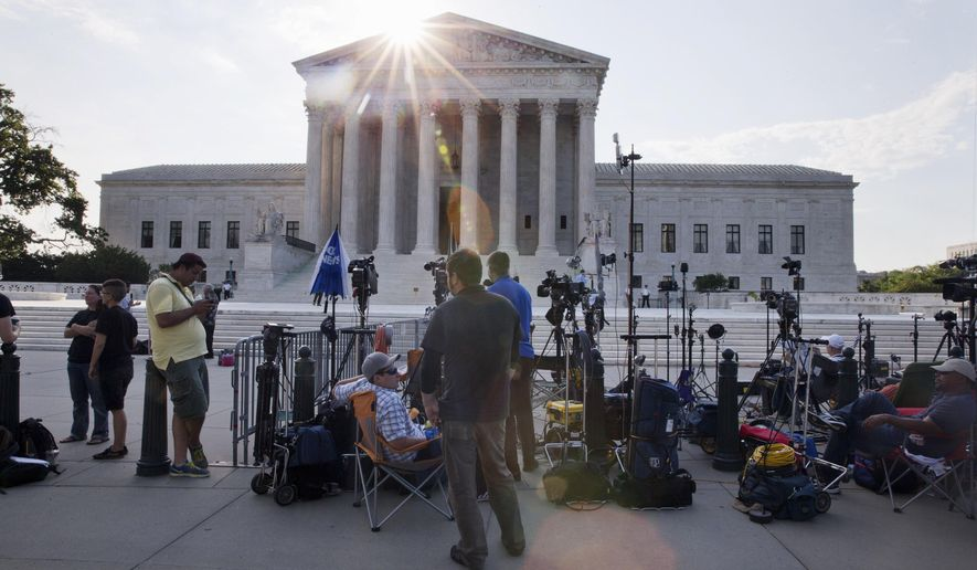 Television crews set up outside of the Supreme Court in Washington, Thursday June 25, 2015. The court is expected to hand down decisions today. Two major opinions, health care and gay marriage, are among the remaining to be released before the term ends at the end of June. (AP Photo/Jacquelyn Martin)