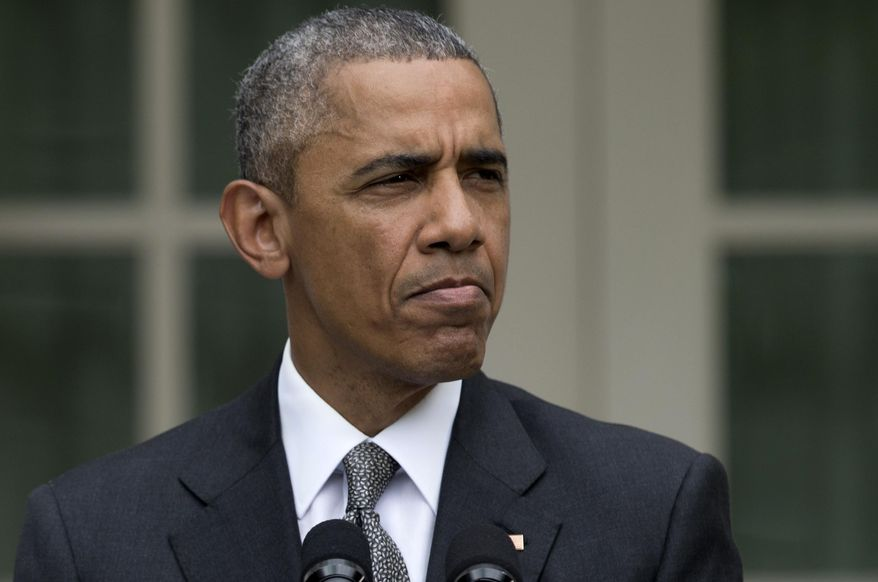 President Barack Obama pauses while speaking in the Rose Garden of the White House, Thursday, June 25, 2015. (AP Photo/Carolyn Kaster)