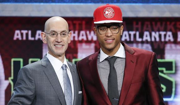 Kelly Oubre Jr., right, poses for photos with NBA Commissioner Adam Silver after being selected 15th overall by the Atlanta Hawks during the NBA basketball draft, Thursday, June 25, 2015, in New York. Oubre was traded on draft night to the Washington Wizards (AP Photo/Kathy Willens) **FILE**
