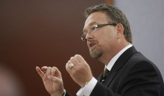 FILE - In this Wednesday, Sept. 17, 2008 file photo, attorney E. Brent Bryson, speaks during O.J. Simpson's trial, at the Clark County Regional Justice Center in Las Vegas. Bryson is representing the B.B. King estate in a case where some of B.B. King's heirs are due to ask a judge in Las Vegas on Thursday, June 25, 2015, not to turn over control of the late music icon's estate to the longtime business manager he named as executor. But a lawyer for the B.B. King estate and designated executor LaVerne Toney says family members' claims that Toney isolated their father, stole from him and poisoned him before his May 14 death at age 89 have no basis in fact. (AP Photo/Isaac Brekkon, Pool)