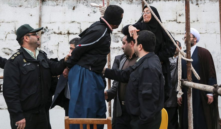 Samereh Alinejad, blindfolded and ready to be hanged, was slapped by the mother of the man he was convicted of murdering then pardoned by the victim's family. Iran executes hundreds of prisoners annually through an opaque legal system that human rights groups say also puts scores of political prisoners behind bars. (Associated Press)