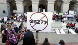 Opponents of a measure requiring nearly all California school children to be vaccinated gathered on the west steps of the Capitol after lawmakers approved the bill,  in Sacramento, Calif., Thursday, June 25, 2015.  The bill, SB277 co-authored by state Sen. Richard Pan, D-Sacramento and Ben Allen D-Santa Monica was approved by the Assembly. (AP Photo/Rich Pedroncelli)