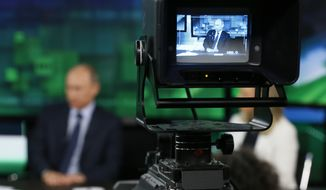 RT was told it risked the seizure of its U.S. bank accounts and the arrest of a senior editor if it failed to comply with the Foreign Agents Registration Act by Monday, according to its editor-in-chief. (Associated Press/File)