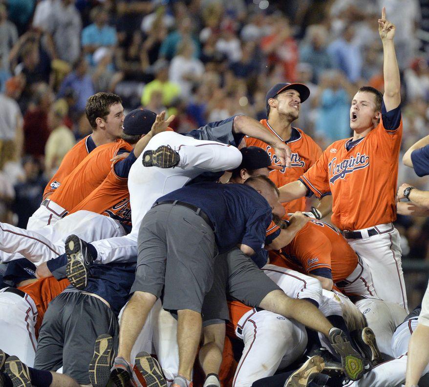 Virginia celebrates winning Game 3 of the best-of-three NCAA baseball College World Series finals against Vanderbilt, 4-2, at TD Ameritrade Park in Omaha, Neb., Wednesday, June 24, 2015. (AP Photo/Ted Kirk)