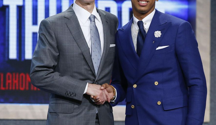 Cameron Payne, right, poses for photos with NBA Commissioner Adam Silver after being selected 14th overall by the Oklahoma City Thunder during the NBA basketball draft, Thursday, June 25, 2015, in New York. (AP Photo/Kathy Willens)