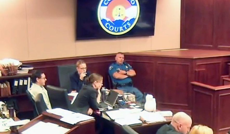 In this image taken from video, accused Colorado theater shooter James Holmes, on the far left, listens to testimony during his trial, in Centennial, Colo., Thursday, June 25, 2015. Holmes arrived at court minus his normal full beard.  (Colorado Judicial Department via AP, Pool)