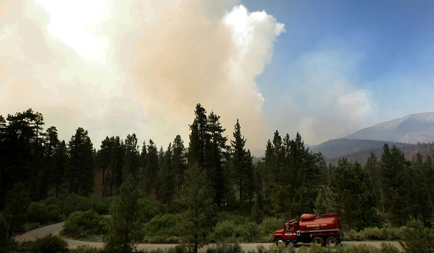A Riverside City Fire Department water truck makes its way down a road towards the Heart Bar campground as a fire continues to burn in the San Bernardino National Forest, California, Thursday, June 25 2015. A huge forest fire that has been burning through rugged terrain in the San Bernardino Mountains for more than a week forced evacuations as it stretched northeast into the desert. (Stan Lim/The Press-Enterprise via AP)  MAGS OUT; MANDATORY CREDIT; LOS ANGELES TIMES OUT