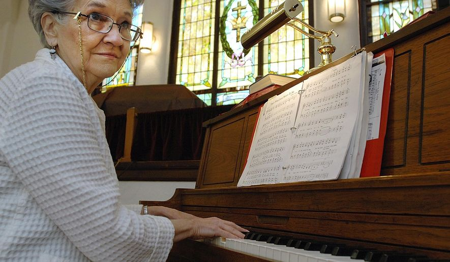 """ADVANCE FOR USE SUNDAY, JUNE 28 AND THEREAFTER - In this May 12, 2015 photo, Jane Conn of Clinton plays piano at the United Methodist Church in Kenney, Ill. Conn can always tell when the child sitting next to her on the piano bench masters a piece of music for the first time. """"I have seen the light bulb come on. When they learn the notes on the staff and see how it goes, they begin to work with the music,"""" said Conn, a piano teacher for more than five decades. Conn has a hard time coming up with an estimate of the number of students, ranging in age from 8 to various stages of adulthood, who have come to her home for lessons over the years. """"It's a bunch, I know that,"""" she said. (Lori Ann Cook-Neisler, The Pantagraph via AP)"""