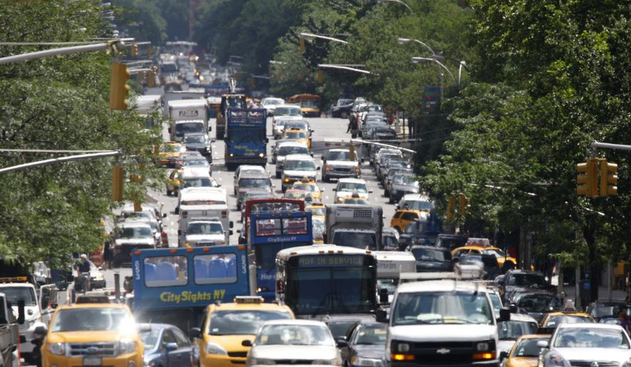 In this June 7, 2010 file photo, taxis, cars, trucks and buses crawl up New York's traffic-congested 1st Ave. (AP Photo/Seth Wenig, File)