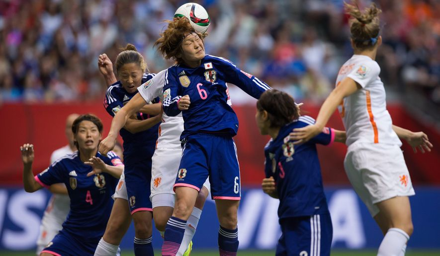 Japan's Mizuho Sakaguchi (6) heads the ball away from her own goal while defending against a Netherlands corner kick during the second half of a round of 16 soccer match at the FIFA Women's World Cup, Tuesday, June 23, 2015, in Vancouver, British Columbia, Canada. (Darryl Dyck/The Canadian Press via AP)