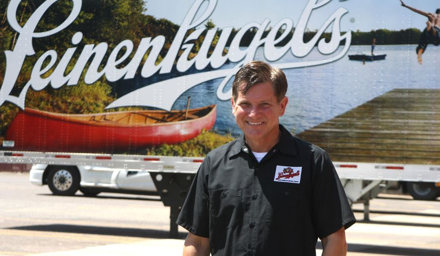 Dick Leinenkugel, president of the Jacob Leinenkugel Brewing Company, stands in front of one of the beer company's trucks in Chippewa Falls, Wis., on June 19, 2015.  Leinenkugel is the man behind the Shandy craze.  (Ross Evavold/The Chippewa Herald-Telegram via AP)