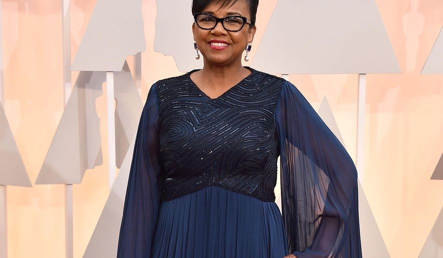 FILE - In this Feb. 22, 2015 file photo, Academy of Motion Picture Arts and Sciences (AMPAS) president Cheryl Boone Isaacs arrives at the Oscars in Los Angeles. Isaacs was elected as the 35th president of AMPAS in 2013. She is the first African American to hold this office. (Photo by Jordan Strauss/Invision/AP, File)