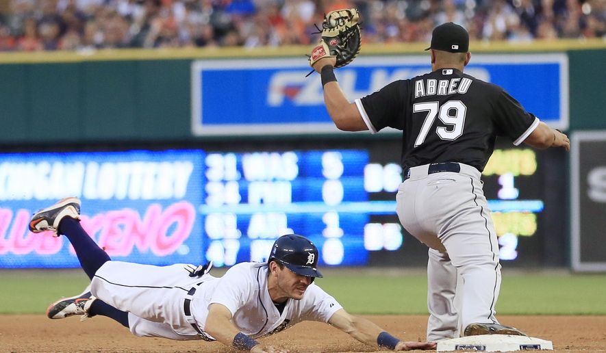 Chicago White Sox's Jose Abreu catches the throw from Carlos Sanchez to complete a double play as Detroit Tigers' Ian Kinsler jumps back to first, on a ball hit by Miguel Cabrera during the fifth inning of a baseball game, Friday, June 26, 2015, in Detroit. (AP Photo/Carlos Osorio)