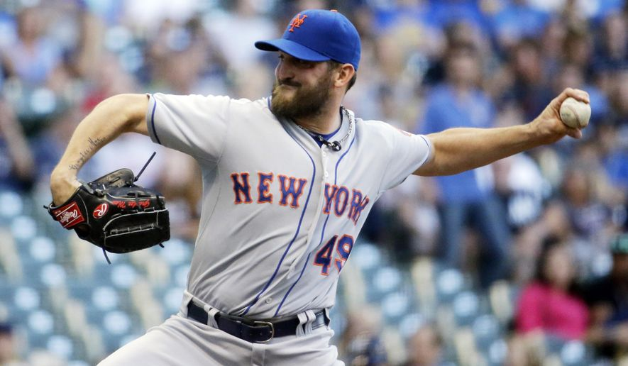 New York Mets starting pitcher Jonathon Niese throws during the first inning of a baseball game against the Milwaukee Brewers Tuesday, June 23, 2015, in Milwaukee. (AP Photo/Morry Gash)
