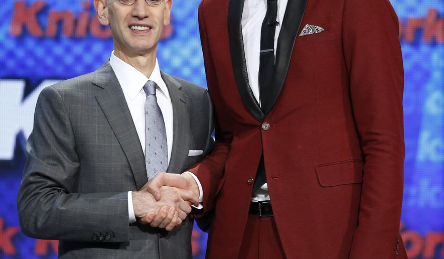 Kristaps Porzingis, right, poses for a photo with NBA Commissioner Adam Silver after being selected fourth overall by the New York Knicks during the NBA basketball draft, Thursday, June 25, 2015, in New York. (AP Photo/Kathy Willens)