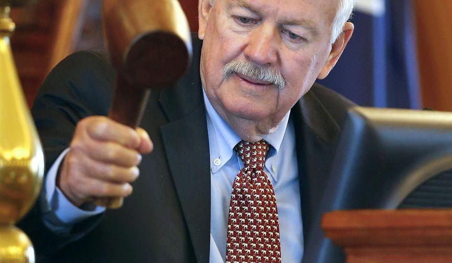 Kansas Speaker of the House Ray Merrick, R-Stilwell, swings the gavel to end the legislative session on Friday June 26, 2015, at the Kansas Statehouse in Topeka, Kan. (Chris Neal/The Topeka Capital-Journal via AP)