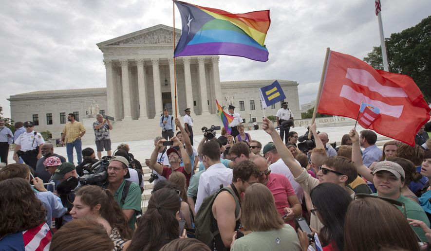 The crowd reacts as the ruling on same-sex marriage was announced outside of the Supreme Court in Washington, Friday, June 26, 2015. The Supreme Court declared Friday that same-sex couples have a right to marry anywhere in the US. (AP Photo/Jacquelyn Martin)