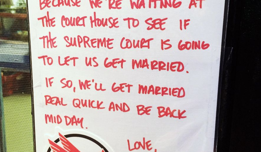 This handout photo provided by Kenneth Denson shows a sign he posted and photographed outside his business on Thursday, June 25, 2015 in Dallas. On Friday, June 26, 2015, the Supreme Court declared Friday that same-sex couples have a right to marry anywhere in the United States, a historic culmination of two decades of litigation over gay marriage and gay rights generally. (Kenneth Denson, via AP)