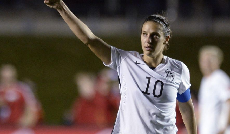 United States' Carli Lloyd (10) looks toward fans after the United States defeatedChina 1-0 in a quarterfinal match in the FIFA Women's World Cup soccer tournament, Friday, June 26, 2015, in Ottawa, Ontario, Canada. (Adrian WyldThe Canadian Press via AP)
