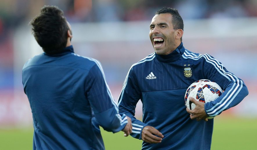 FILE - In this June 13, 2015 file photo, Argentina's Carlos Tevez, right, shares a laugh with teammate Ezequiel Lavezzi prior a Copa America Group B soccer match against Paraguay at La Portada stadium in La Serena, Chile. The president of Boca Juniors Daniel Angelici says Tevez is leaving Juventus to return to the Buenos Aires club and will sign a contract when the Copa America ends next week. (AP Photo/Natacha Pisarenko, File)