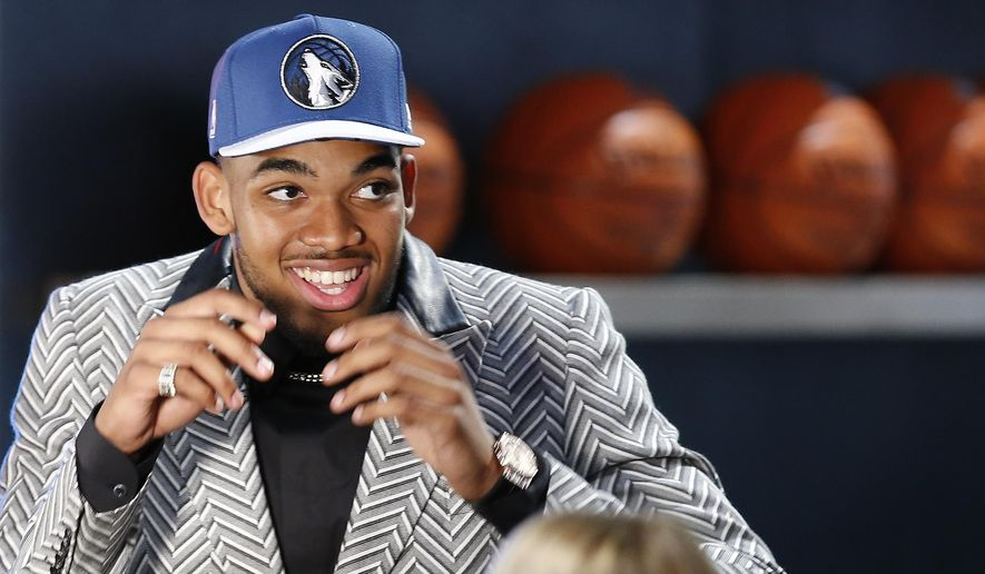 Karl-Anthony Towns reacts after being selected first overall by the Minnesota Timberwolves during the NBA basketball draft, Thursday, June 25, 2015, in New York. (AP Photo/Kathy Willens)