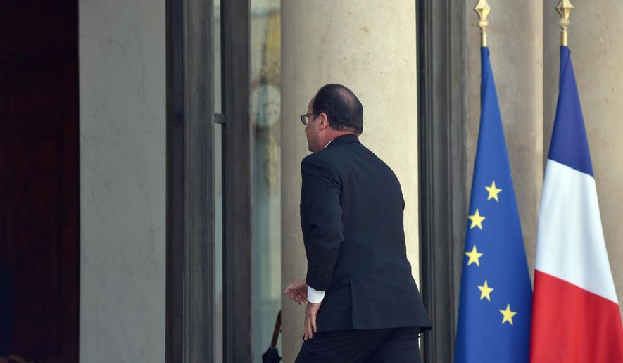 French President Francois Hollande arrives at the Elysee Palace in Paris, France, to preside a high level security meeting following a terrorist attack which took place near Lyon, central France, Friday, June 26, 2015.  An attacker with suspected ties to French Islamic radicals rammed a car into an American gas factory Friday in southeastern France, officials said, adding that a severed head and banners with Arabic inscriptions were found at the factory's entrance. France immediately opened a terrorism investigation. (AP Photo/Zacharie Scheurer)