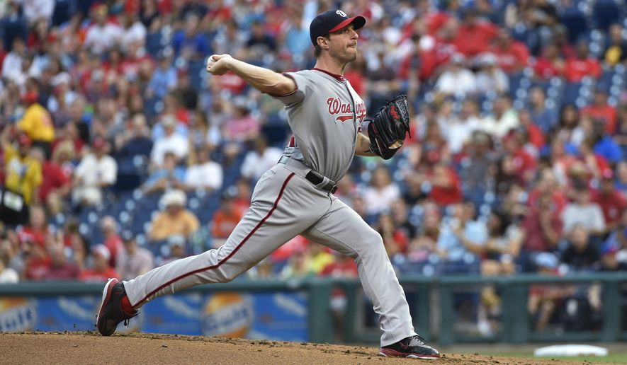 Washington Nationals' Max Scherzer pitches during the first inning of a baseball game against the Philadelphia Phillies, Friday, June 26, 2015, in Philadelphia. (AP Photo/Derik Hamilton)