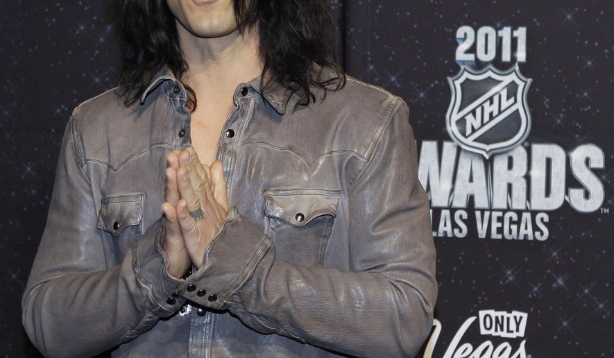 """FILE - In this June 22, 2011, file photo, Criss Angel is photographed on the red carpet before the 2011 NHL Awards in Las Vegas. Angel's rescue Wednesday, June 24, 2015, of an escape artist trapped in a glass cage filled with water was no illusion. Angel and Spencer Horsman were rehearsing for opening night of """"The Supernaturalists"""" at an eastern Connecticut casino when Horsman became trapped in the cage dangling above the stage and Angel went to his aid. (AP Photo/Julie Jacobson, File)"""