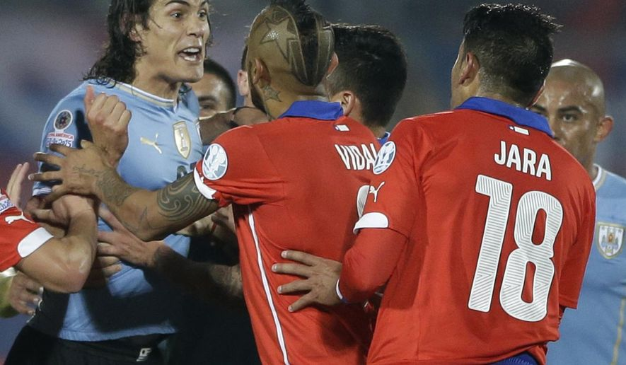 Uruguay's Edinson Cavani, left, argues with Chile's Gonzalo Jara, right, during a Copa America quarterfinal soccer match at the National Stadium in Santiago, Chile, Wednesday, June 24, 2015. South American football officials will look into the actions of Jara, who was caught by TV cameras poking Cavani's behind to provoke a red card, which could lead to a suspension for the Chilean player. Cavani, Uruguay's top striker in the South American tournament, was sent off after the provocation by Jara, and Chile went on to win 1-0. (AP Photo/Ricardo Mazalan)