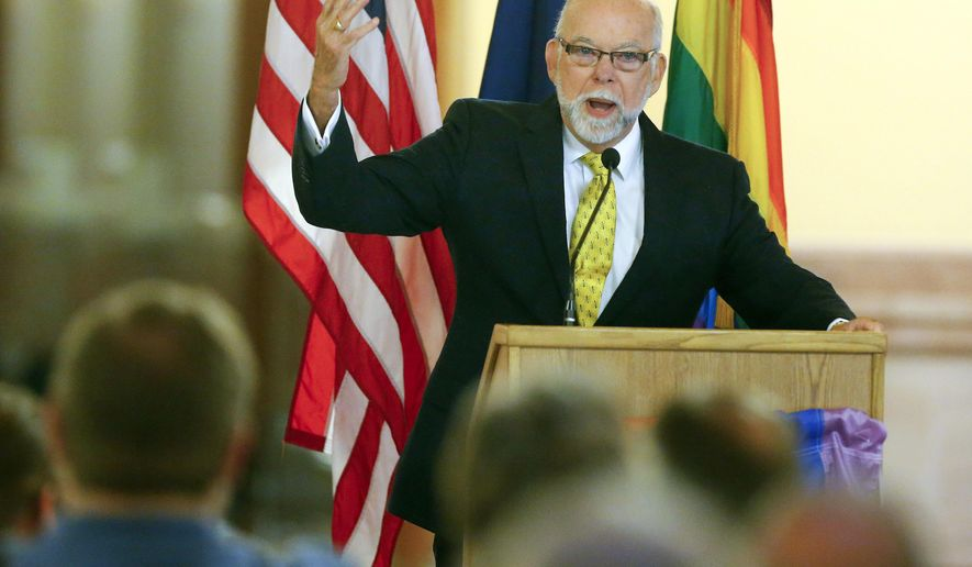 Topeka attorney Pedro Irigonegaray gives a speech about freedom during a LGBT rally on Friday, June 26, 2015, at the Kansas Statehouse in Topeka, Kan. The Supreme Court's decision extends the right to marry to same-sex couples nationwide. (Chris Neal/The Topeka Capital-Journal via AP)